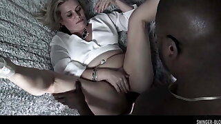 Busty swinger MILF Heather C Payne choking on a black cock