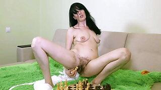 Evil Eva Masturbates with a Chess Board